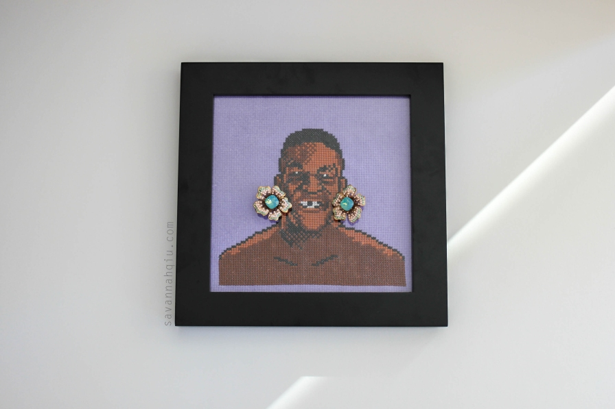 Mike Tyson cross stitch art, by Calgary artist; Floral Swarovski crystal earrings, Aldo accessories.